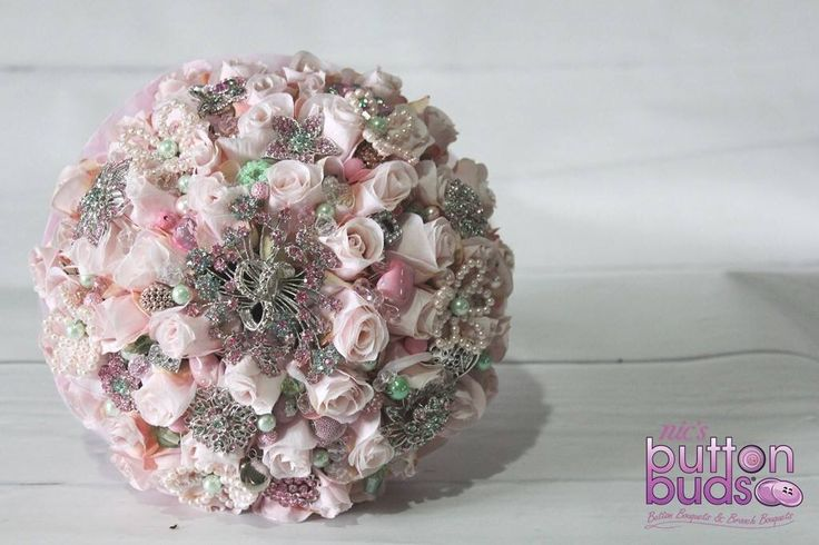 Perfect pastels to replicate spring. Every bride needs a bit of a bling. Tiny pearls to add a touch of class, silver brooches set to last. Turquoise and pink are the perfect pair, this bouquet would add a vintage flair. #nicsbuttonbuds @nicsbuttonbuds #iddoanything #needtowin