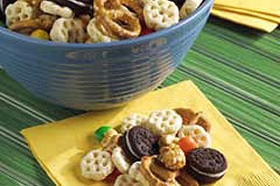 Sweet and Crunchy Snack Mix recipe. Sometimes I make baggies of this instead of cupcakes for a class b-day party.  I mix up the cereals too!