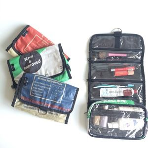 The Ranya Toiletry bag is made of recycled cement bags and has handy clear pockets for convenience. It is super light and comes in 3 colours - red/green/blue.