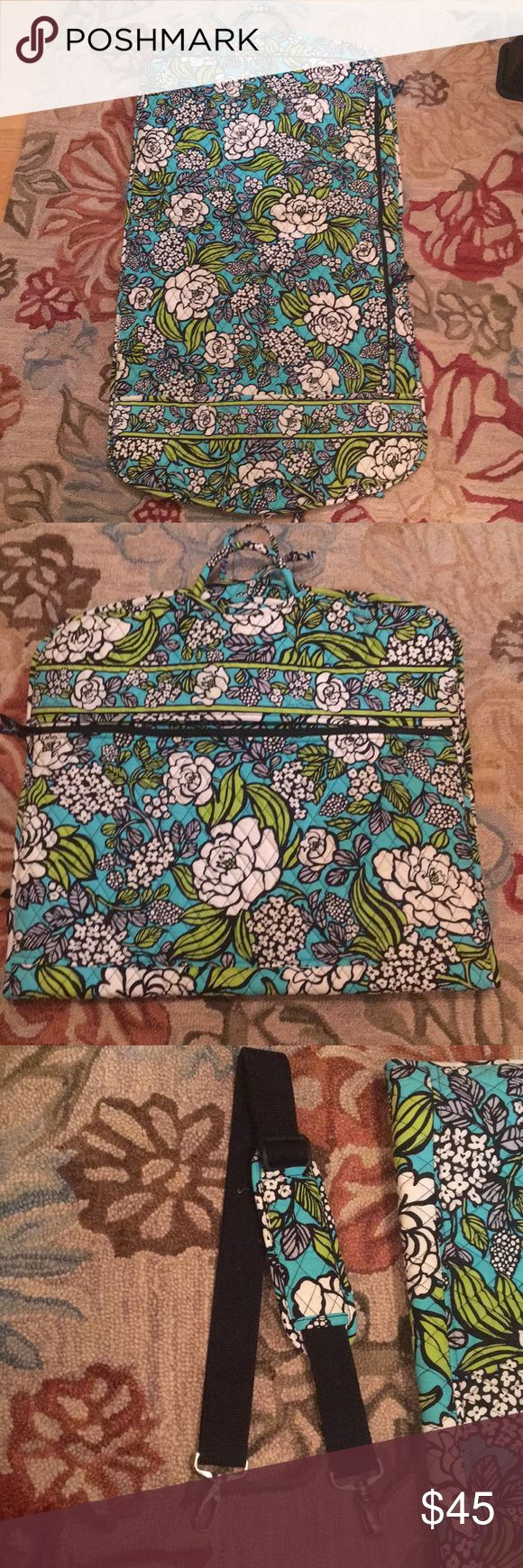 NWOT Vera Bradley Garment Bag Hanging garment bag by Vera Bradley.  Gorgeous aqua and white flower pattern.  Signature quilted style.  Never been used.  42 inches when unfolded, 22 inches across. Vera Bradley Bags Travel Bags