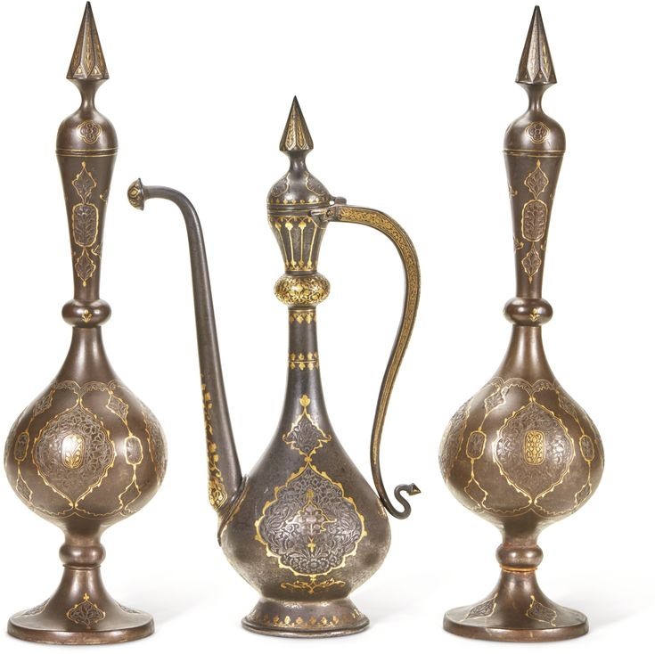Two gold damascened steel bottle vases and a ewer, Persia, Qajar, second half 19th century Quantity: 3 bottle vases: 45cm. each ewer: 39cm.