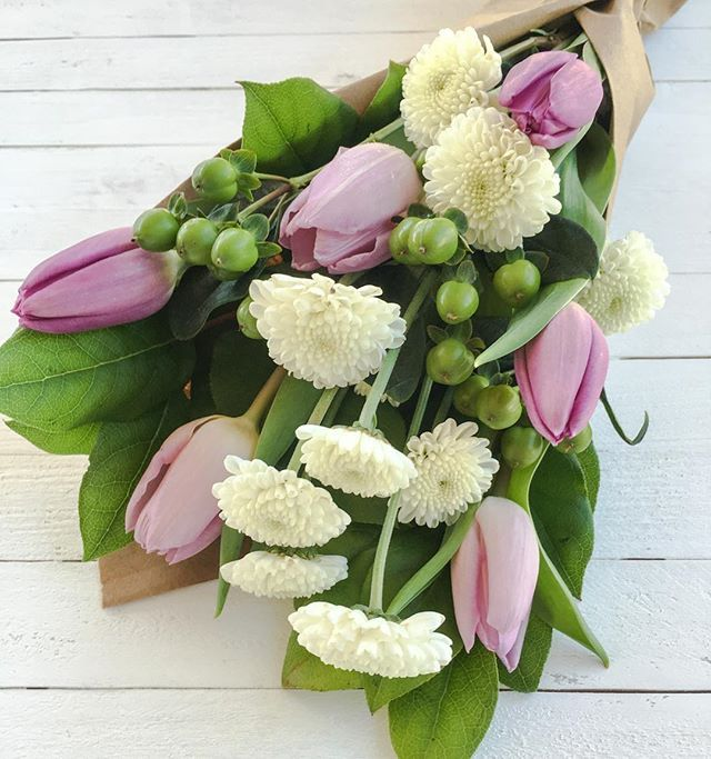 """This week's posy: Royal Tulips, Hypericum, and Snow Buttons.  It's time for another public display of affection: """"You're the one I text when I'm drunk.  That's true love."""" When we're inebriated, we text our Web Developer, our Social Media Manager, our Mom, Dad, Brother, Dog, Cousin, etc.  Not sure if that's true love on our part, it's true boredom.  Have an amazing week Phoenix! $30 including delivery  Order: mylittleposy.com ✌️and , MLP  #love #photooftheday #cute #beautiful #happy…"""