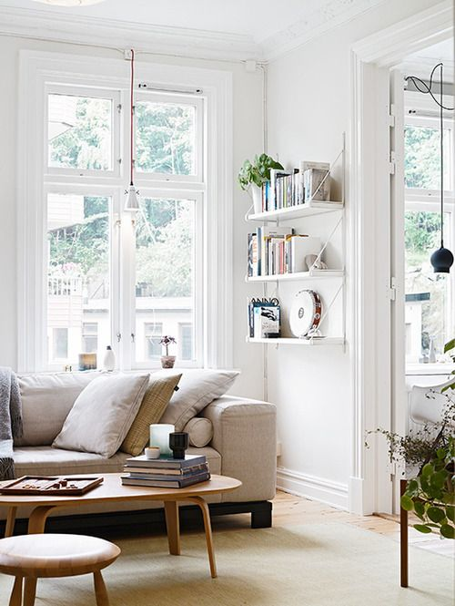 "Ikea ""Ekby Järpen/Gällö"" shelves in nude living room"