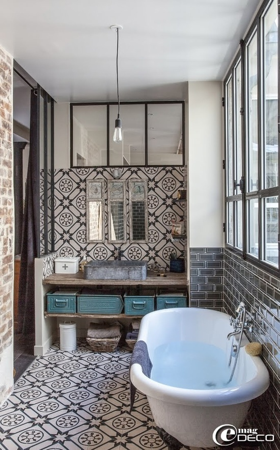 fantastic external tub, tile, and brick. bathrooms are a fun place to go crazy with pattern.