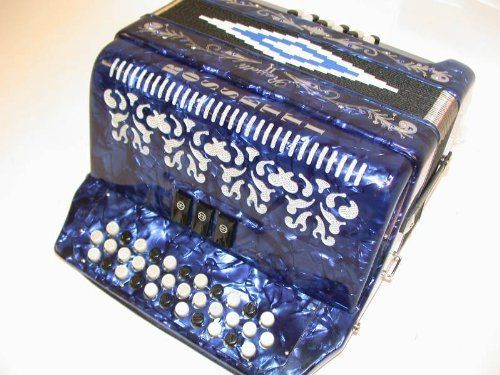 Rossetti 34 Button Accordion 12 Bass 3 Switch Key of FBE, with Case, in BLUE by Rossetti. $397.00. Features:   Rosetti Button Accordion  Diatonic - three switch   Key of FBE Italian style decorations  Bright pearlescent colors  Custom grill design  Color: Blue  12 Bass buttons  34 Treble buttons  3 switches   20 fold sheepskin bellows with reinforced corners for longer life    Slide lever air intake valve  Includes hard shell locking case, aluminum reinforced edges and corne...