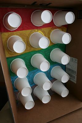 punch out party board for treats (behind tissue paper inside plastic cups) - such a different idea...easier than the paper bags