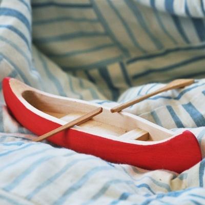 Wooden toy canoe