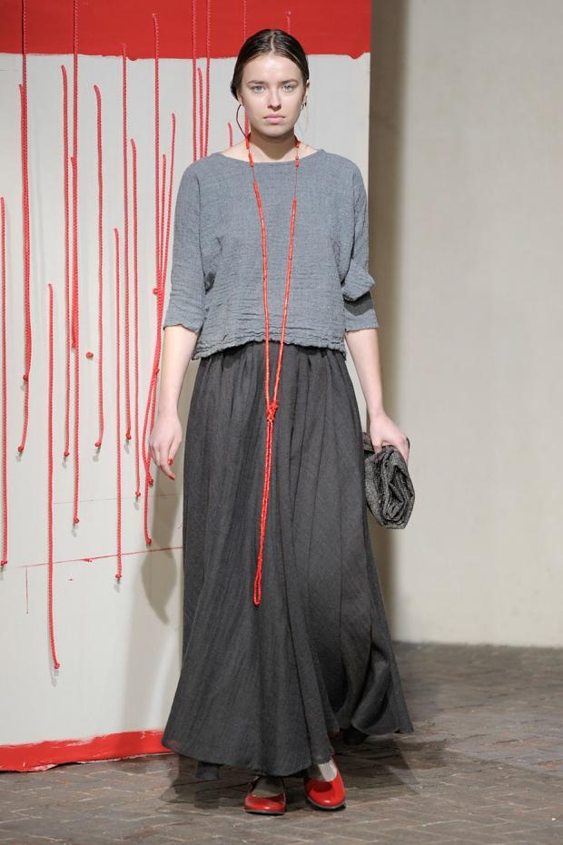 Maxi skirt, colour, shoes and necklace.... I like the splash of red with the grey.