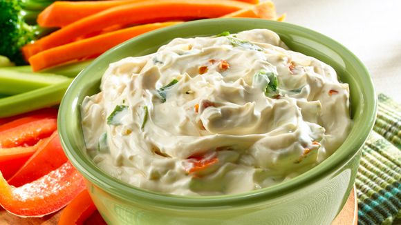1 pkg Knorr Vegetable recipe mix, 1/2 cup Mayo, 1 container (16oz.) of sour cream. Mix. Stick in the fridge for 2 hours to let the veggies soften. Serve with chips or veggie stix.