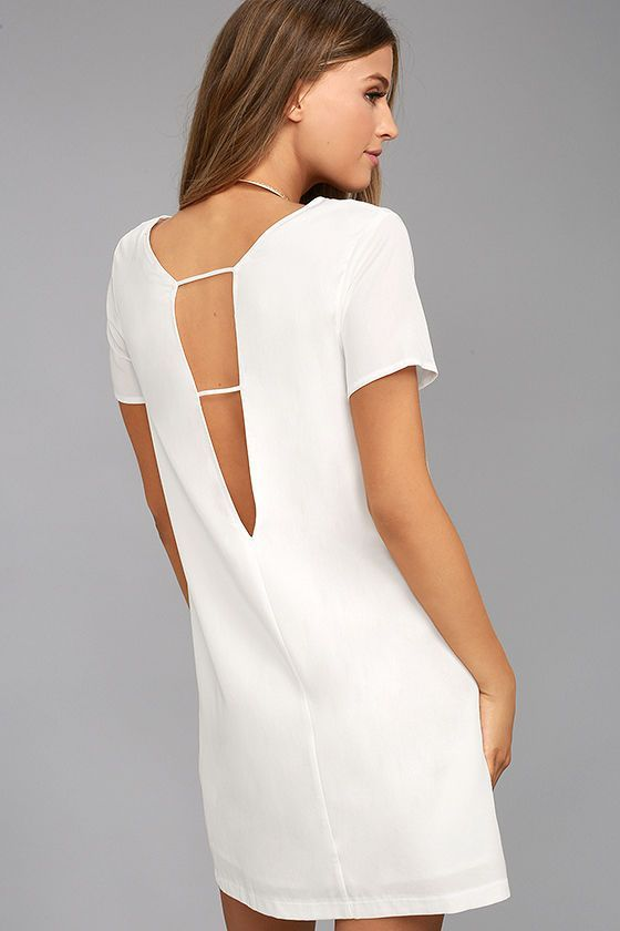 Take a mini vacation every time you slip on the Mumbai the Way White Shift Dress! Soft and sleek woven fabric shapes short sleeves, rounded neckline, and straight-cut bodice with darting. The effortlessly cool silhouette gets a sultry peek of skin at back, thanks to a strappy V cutout.