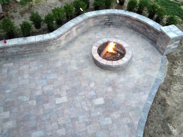 Gas Fire Pit With Tumbled Unilock Brick Paver Wall And