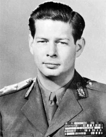 King Michael of Romania (b. 25 Oct. 1921), 2nd son of King Carol II of Romania.  Michael, son of Carol's 2nd wife Princess Helen of Greece and Denmark, was undeniably legitimate so he, and not his older brother Carol/Prince Mircea, was his father's heir.  He reigned twice, once from 1927-1930 and again from 1940 until 1947 when he was forced to abdicate by the Reds.