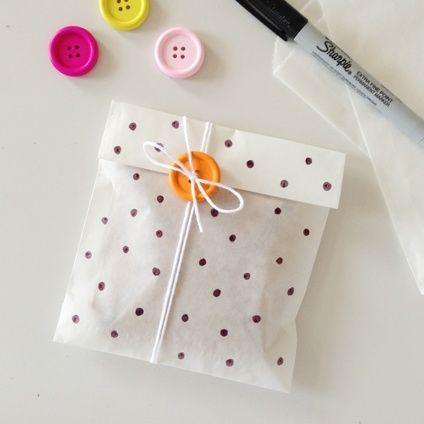 sweet glassine bag decorated with a sharpie and a wood button to help fasten the…