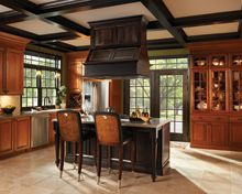 Design your kitchen with a focal point for entertaining, the center island and wood hood create a great centerpiece for gathering.
