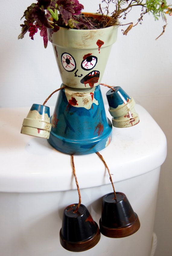 Halloween themed Zombie flower pot person by SchumArt on Etsy