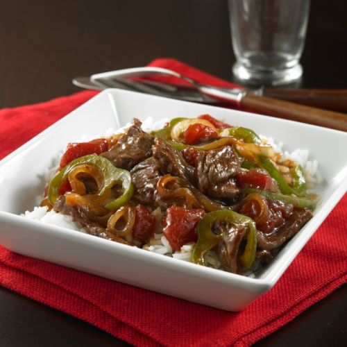 Pepper Steak: Juicy strips of beef sirloin steak tossed with bell peppers, onions and tomatoes in a stir fry sauce