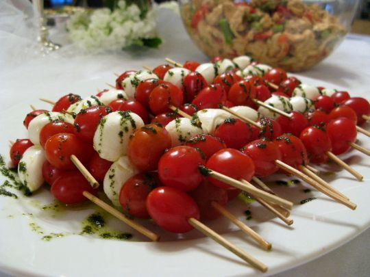 caprese salad on a stick.  love this for a backyard cookout.  cannot wait for summer!