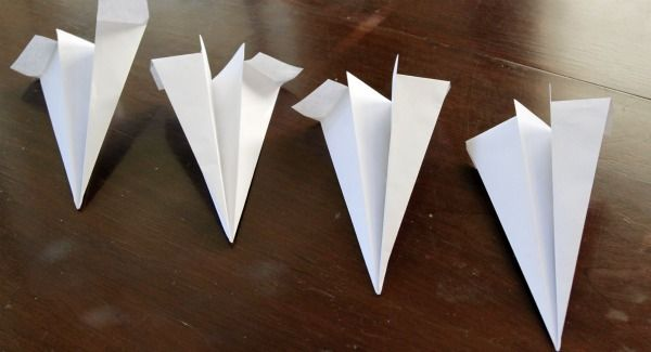 Paper Airplane Game set up. How do airplanes fly?  Why don't they fall out of the sky?  Experiment with different types of paper airplanes to discover what designs are the most aerodynamic – measure how far your airplanes travel.