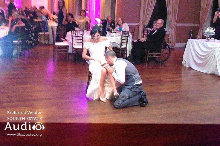 A festive garter toss at Arrowhead Golf Club. http://www.discjockey.org/real-chicago-wedding-october-10-2015/