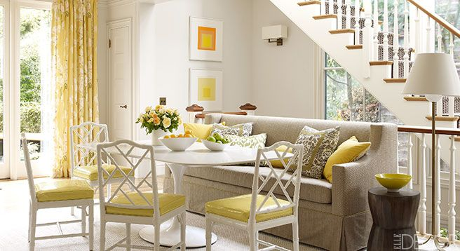 A Caesarstone tabletop and chairs by Jonathan Adler at the breakfast room of this California home on Elle Magazine