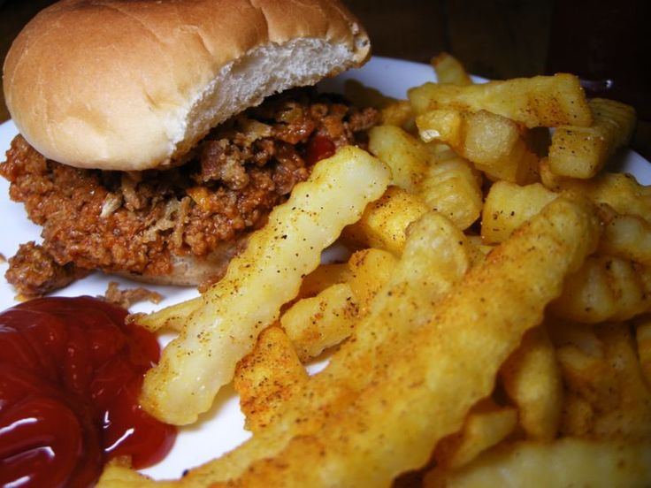 Ingredients    2 lbs Ground beef, browned and drained  2 cups french fried onions  1 pack hamburger buns  1 cup shredded cheddar cheese  1 can manwich sloppy joe sauce
