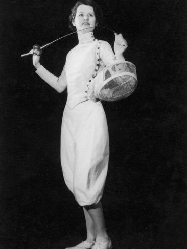 Vintage fencing togs...for me! I learned to fence at age 7 with an Italian foil. When I got to be a teenager, this was pretty much what I wore for competitions. I had to wear knee-socks & the pants were a bit tighter.