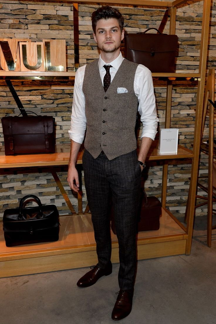 When:6 January 2014 Where:Mulberry Celebrates London Collections: Men,London, UKWearing: Topman waistcoat, Burberry waistcoat and Loake shoes