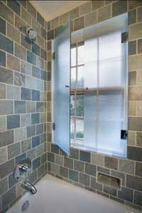 How to protect Window in shower from water spray.