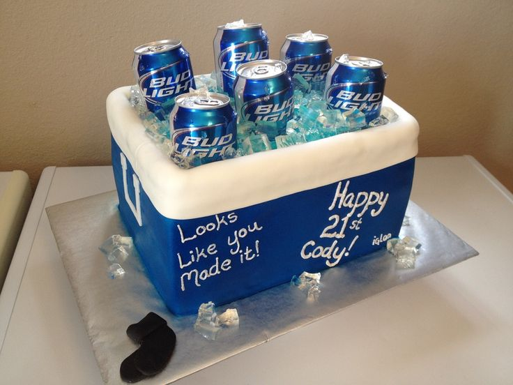 2 layers of cereal treats and two layer 9x13 white cake with Snickers buttercream filling. Covered with fondant and airbrushed blue. Ice is jello made with flavored water. Beer cans are real (emptied from the bottom). The little pair of black socks is because the birthday boy keeps losing his.