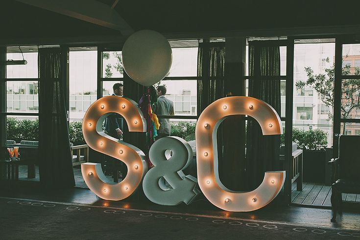 Giant light up letters with the initials of the bride and groom | Photography by http://www.nabeelscamera.com/