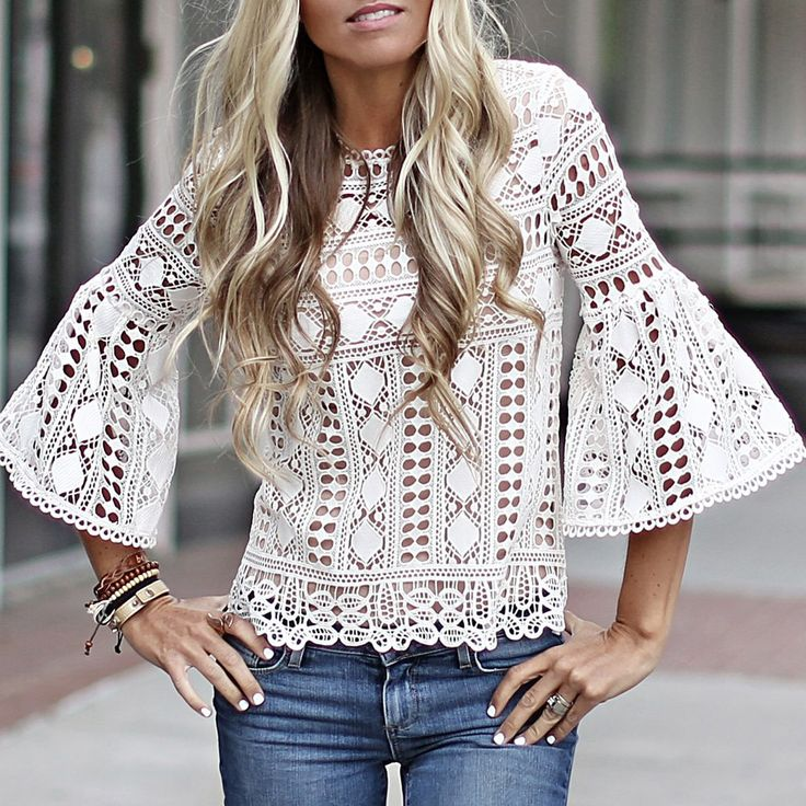"""We love the feminine classic feel of this lace top with it's dainty neckline detail and bell sleeve. The fit is flattering and super chic. We love it """"Coco Chanel"""" style with a pencil..."""