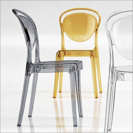 Parisienne acrylic dining chair. Beautiful to look at and comfortable to sit in.