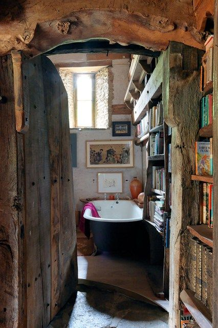 Bathroom With Bookshelves In A Magical Barn Conversion. Photo Simon Brown, House & Garden UK