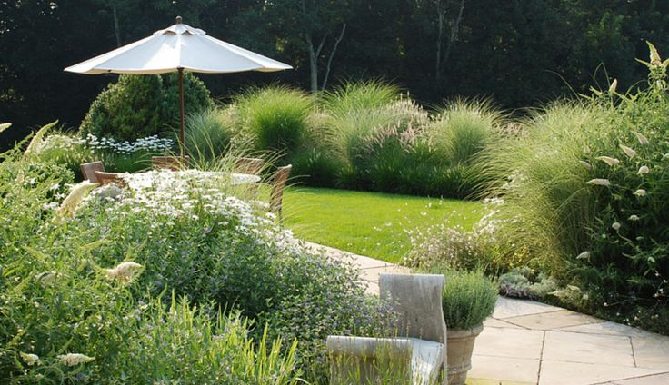 Terrace Seating And Grasses | providence landscapes - this looks like a nice place to relax...