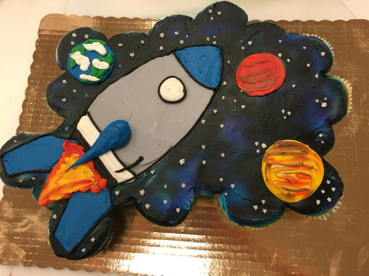 Space cupcakes.  24 cupcake cake decorated with buttercream