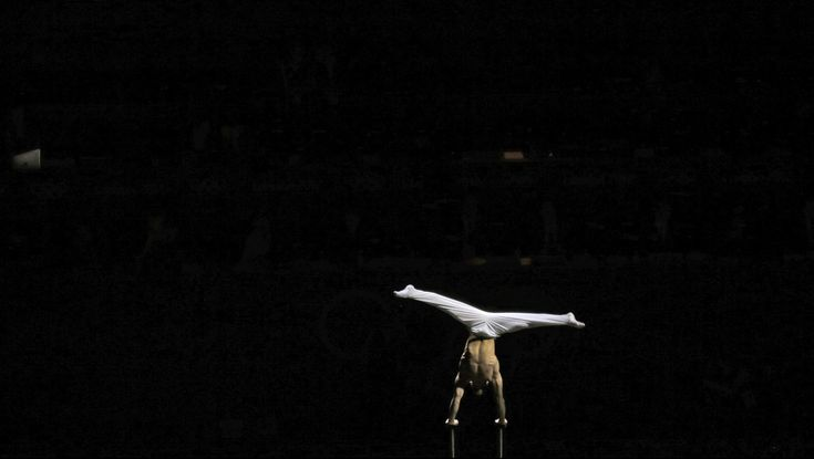 FOR USE AS DESIRED, YEAR END PHOTOS - FILE - In this Aug. 5, 2012 file photo, an artist performs during a pre-show for the artistic gymnastics apparatus finals at the 2012 Summer Olympics in London. (AP Photo/Gregory Bull, File)