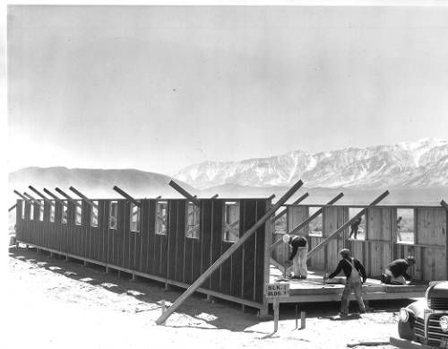 """Page 1 :: """"Barracks To House Evacuated Japanese -- The first of 350 such barracks to house 10,000 Japanese evacuated from Southern California cities"""" -- caption on photograph :: Japanese American Relocation Digital Archive, 1941-1946. http://digitallibrary.usc.edu/cdm/ref/collection/p15799coll75/id/1644"""