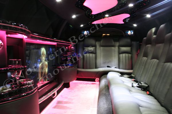 """Chrysler 300C stretch limousine interior with massive 40"""" TV screen + rear seating for 10 PAX"""