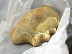 Taking a cue from Cornish pasties (know in West Cornish dialect as tiddy oggy (!), these are little moon-shaped handheld pastries filled with savory ingredients. Hugh Fearnley-Whittingstall offers up three filling variations in River Cottage Every Day—leftover stew, lentil and squash, and chicken and leek.