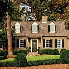 yellow brick house with black shutters, black door - well, here's an idea for our San Patricio house!