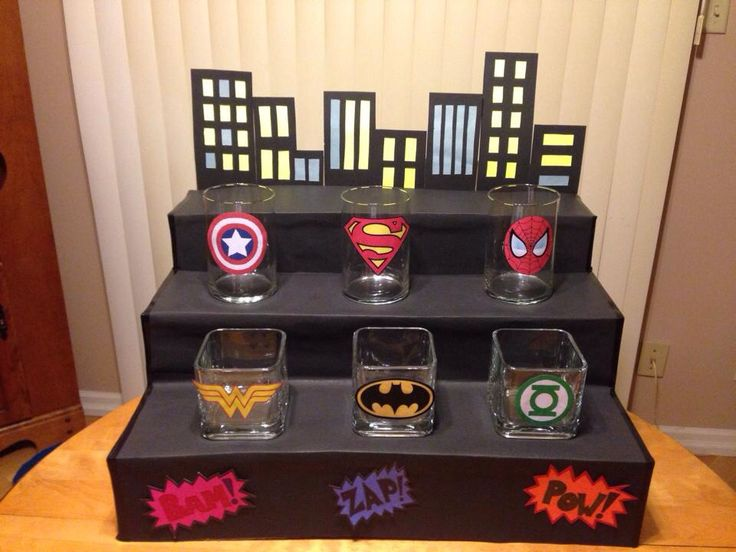 Superhero candy bar for kids party! Made out of cardboard, coloured construction paper, glass bowls and printed out superhero logos! Add your own choice of candy!! Batman, Superman and Wonder Woman!!
