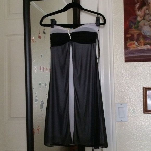 Formal Dress This beautiful black and white formal dress has only been worn once and is in perfect condition! B. Darlin Dresses