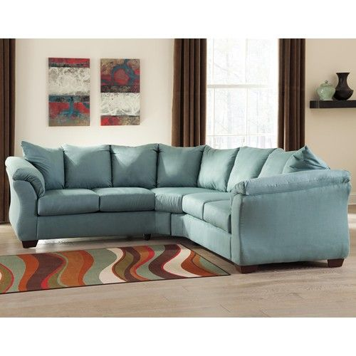 with the exciting contemporary style of the sweeping padded arms and plush pillow back design the sleek beauty of the darcy sky sectional living room set