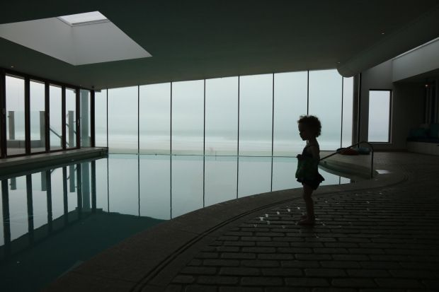 Toddler on holiday in UK at Watergate Bay Hotel in Cornwall. We loved swimming in the infinity pool. The Jo Jo Maman swimming costumes were amazing.
