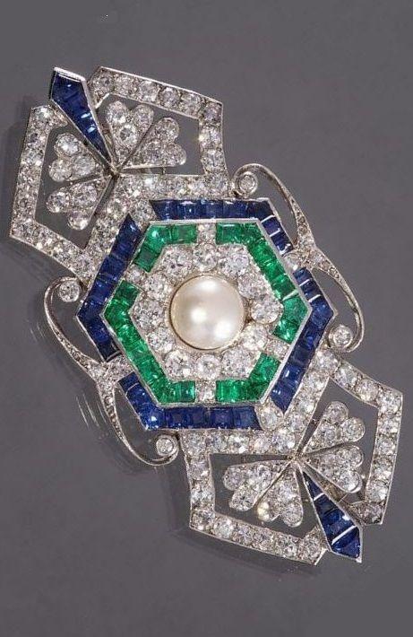 An Art Deco platinum, diamond sapphire and emerald brooch, circa 1925.