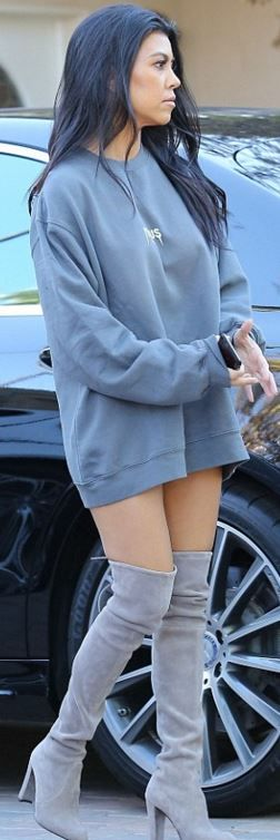 Who made  Kourtney Kardashian's gray sweatshirt and suede thigh boots?