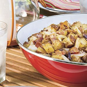 Picnic-friendly grilled potato salad is a fun, tasty twist on this traditional summer side. Grilling the potatoes gives the dish a smoky flavor while the simple 3-ingredient dressing adds a tangy note. Serve warm with barbecued pork, grilled chicken, or juicy steaks.