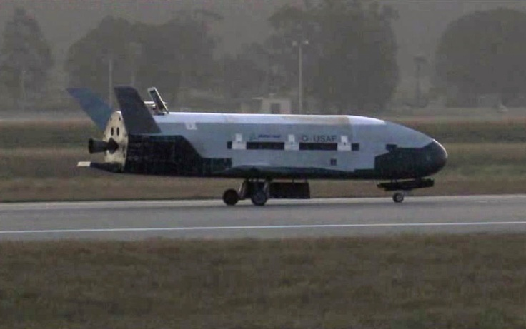 OTV-2. This image from video made available by the Vandenberg Air Force Base shows the X-37B unmanned spacecraft landing at Vandenberg Air Force Base, on June 16, 2012. The spacecraft, which was launched from Cape Canaveral Air Force Station in Florida in March 2011, conducted in-orbit experiments during a 15-month clandestine mission, officials said. It was the second such autonomous landing at the base. (AP Photo/Vandenberg Air Force Base)