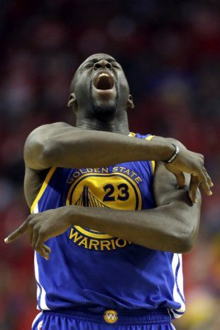 Draymond Green celebrates after hitting a 3-point shot during the second half of Game 4. (AP/David J. Phillip)