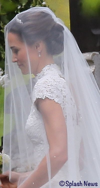 Pippa's veil was by renowned milliner Stephen Jones, made from fine tulle with a dégradé of embroidered pearls. ©Splash News